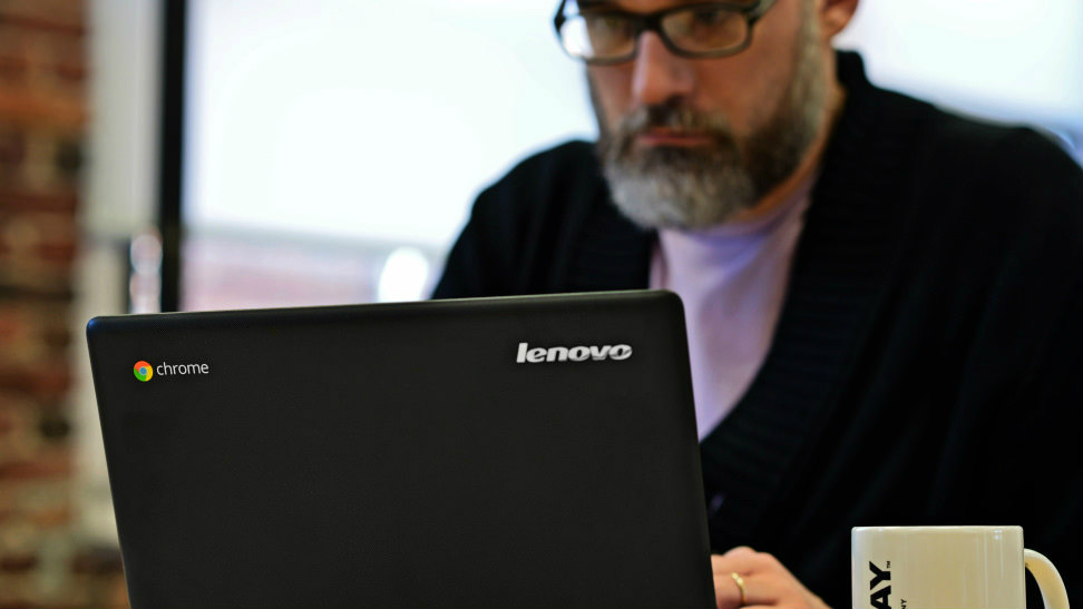 man using a Chromebook